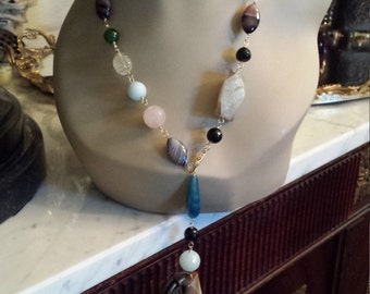 One long strand multi stone necklace designed with adjustable lenght