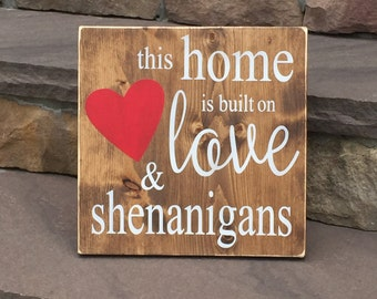 """Wooden This Home is Built on Love & Shenanigans Sign (approx. 11.25"""" x 11.25"""")"""