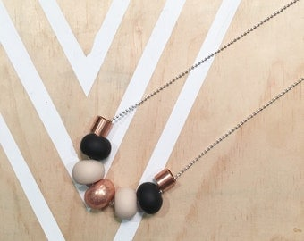 Polymer clay beaded necklace. Neutrals / copper glitter / copper tube bead