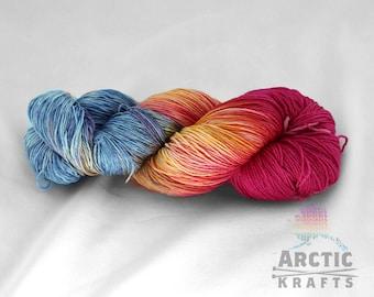 Arctic Sunrise, hand dyed 75 superwash ultrafine merino wool, 25 silk sock yarn. 437 yards