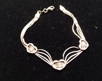 Vintage 925 sterling silver three heart bracelet