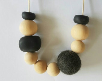 Natural wooden,  clay bead and felt ball necklace.
