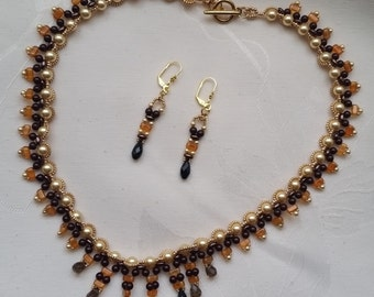 Woman dress, necklace and earrings and brown jet