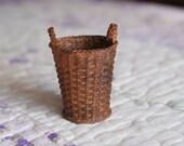 A miniature brown basket