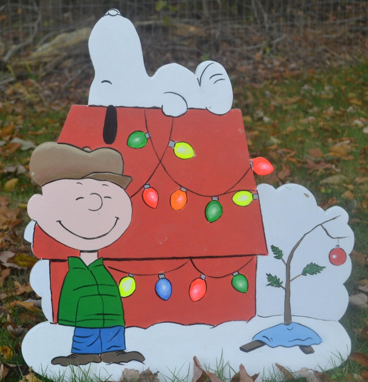 Charlie Brown and Snoopy hanging Christmas lights