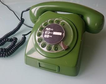 Vintage rotary phone, Yugoslavian communist phone, green old phone