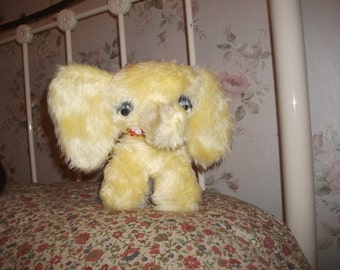 retro vintage soft toy elephant trunk up lemon colour
