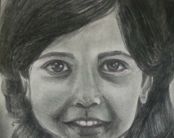 Custom hand-drawn charcoal portraits