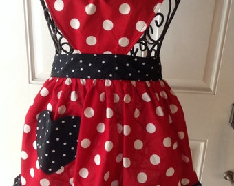 Child's ruffled apron with a sweetheart bodice