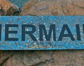 Brass Mermaid sign