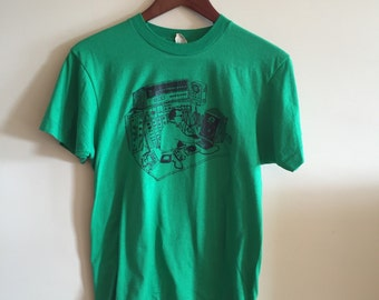 Vintage 1980's Screen Stars T-Shirt depicting a DJ in the studio. Very rare!