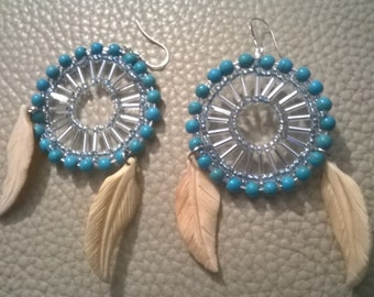 earring with turquoise and garfed feathers from buffel bone
