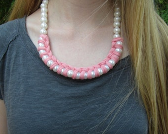 Pink Fabric and Pearl Necklace