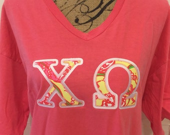 chi omega specialty lilly pulitzer fabric v neck t by comfort colors with greek stitched letters