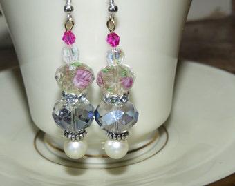 Handmade pierced earrings. Rhinestone, pink, and pearl.