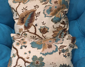 Brown, cream and teal throw pillows