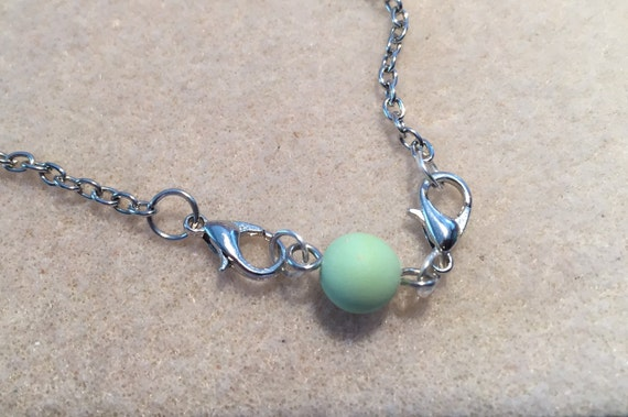 1 Lava Bead or Aroma Bead Essential Oil Nape Extender. Extends Jewelry by 1 inch. Adds Oil to Existing Jewelry. Clip to Necklace Bracelet