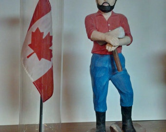 A souvenir from Kanada - The little Giang figure and a mini banner of Canada