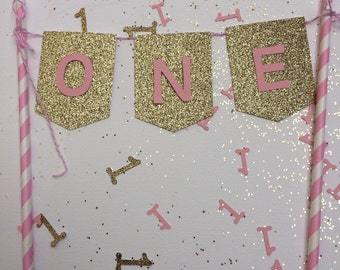 First birthday gold glitter and pink paper straw cake topper