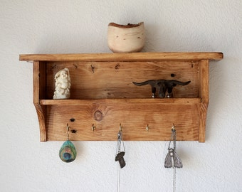 Shelf with hooks.