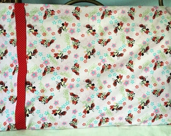 Minnie Mouse Pillow Case with coordinating red with white polka dot contrast band.