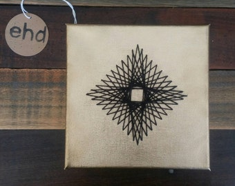 Gold and Black Stitched Geometric Diamond on Canvas