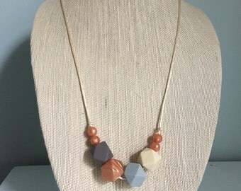 Luca Rosie the Riveter Silicone Teething Necklace