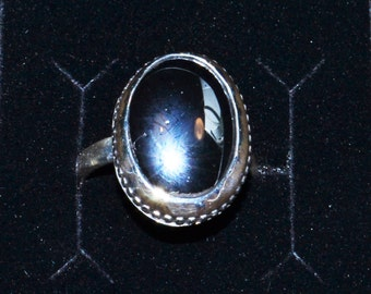 9 Carat Hematite oval Cabochon, bezel set in a 925 Sterling Ring, size 7