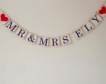 Personalised Mr and Mrs wedding bunting with two hearts, wedding venue decorations