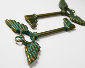 1x Skeleton Key Pendant - Heart Wings - Flying Heart - Key Charm - Bronze With Green Patina - Jewelry Supplies - Bronze Key - Key Pendant
