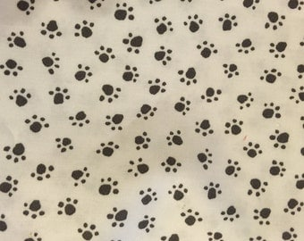 Charcoal paw-prints on white fabric by Michael Miller
