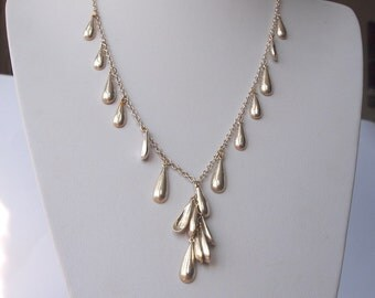 Stunning vintage silver tone metal chain necklace decorated with silver drop charms