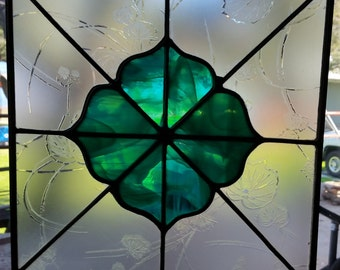 Leaded stained glass panel. Frosted clear glass with green center. Sun catcher