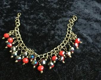 Glass beaded charm bracelet, steampunk style!