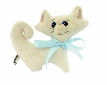 Kitten. A small, soft, toy with a delightfully touchable, plush fabric body and cute expression.