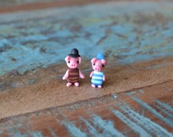 Miniature figures: two pretty piglets