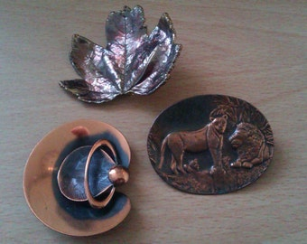 3 vintage copper coloured brooches