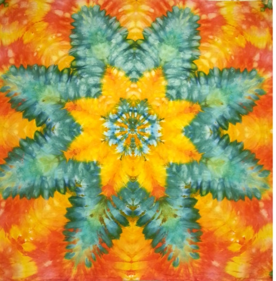 mandala star tie dye tapestry orange turquoise red yellow wall