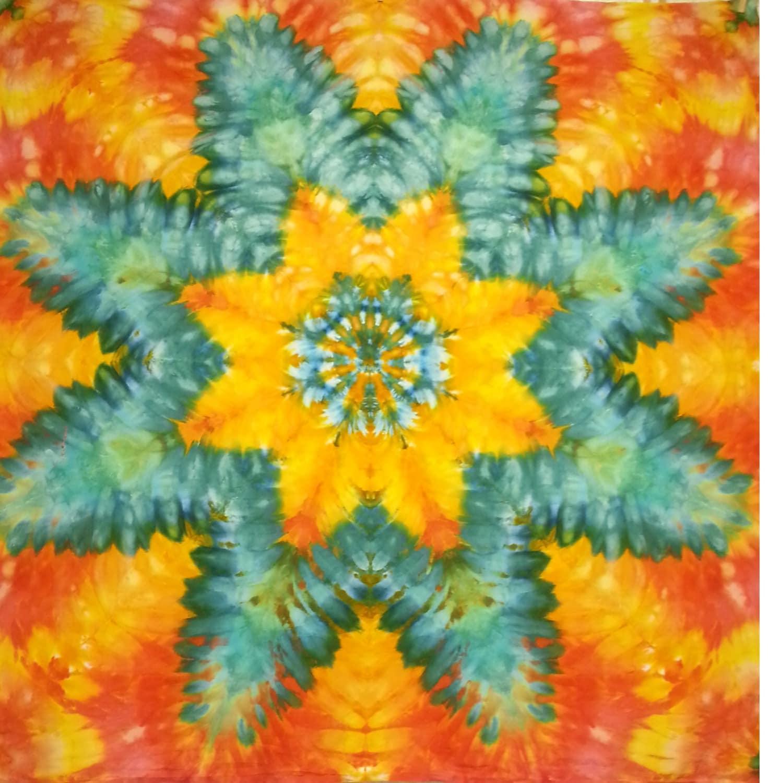 mandala star tie dye tapestry orange turquoise red yellow wall