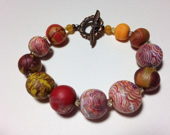 Artist made polymer clay beaded bracelet