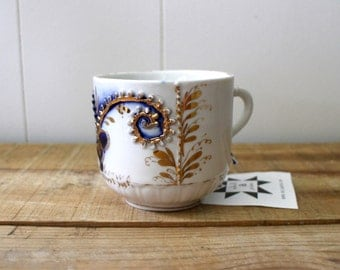 antique flow blue mustache cup
