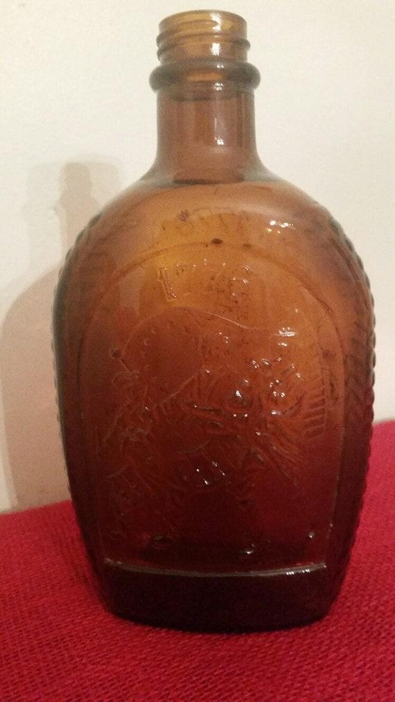 Log cabin syrup bottle