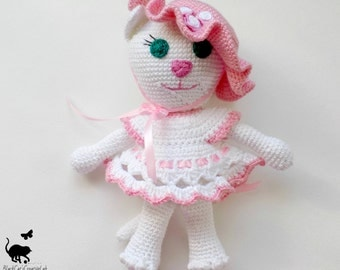 Lady Cat.  Knitted toy amigurumi. Cat in hat and dress. Toy amigurumi