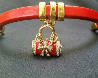 Red leather charm bracelet with gold magnetic clasp