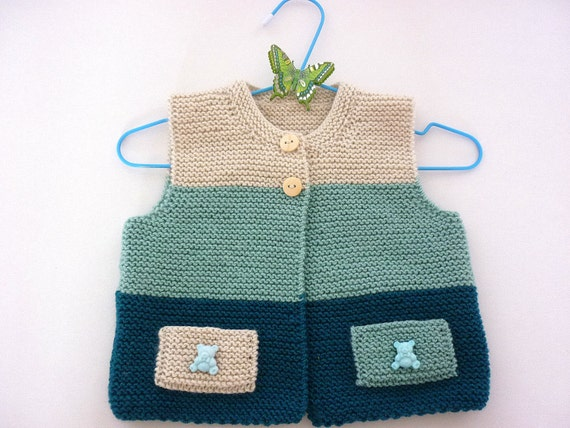 Knitted baby vest.Knitted baby cardigan.Newborn