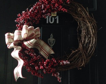 Grapevine wreath with berries and bow