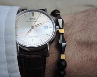 Luxury Onyx bracelet with gold and black hematite beads.