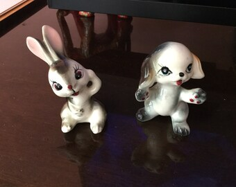 Two beautiful little figurines of a dog and rabbit
