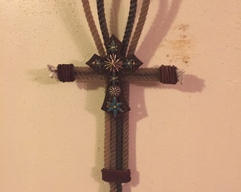 Handmade laroat rope cross with leather detail