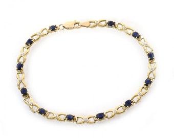 2.00 Carat Sapphire and 0.05 Carat Diamond Accent XO Link 10K Yellow Gold Bracelet